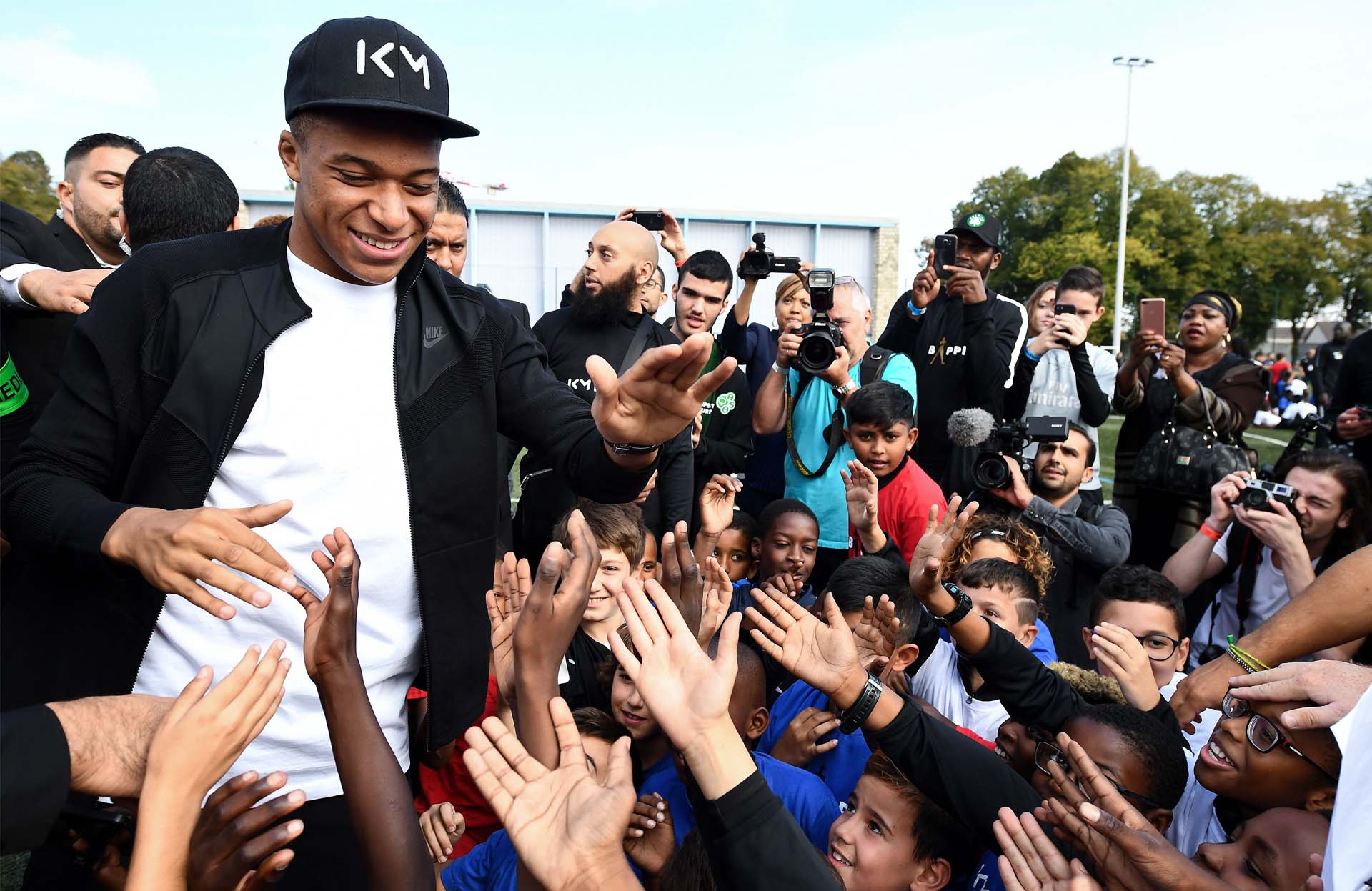 384e7ed82a5 Kylian Mbappé Returns To Hometown As World Champion - SoccerBible.