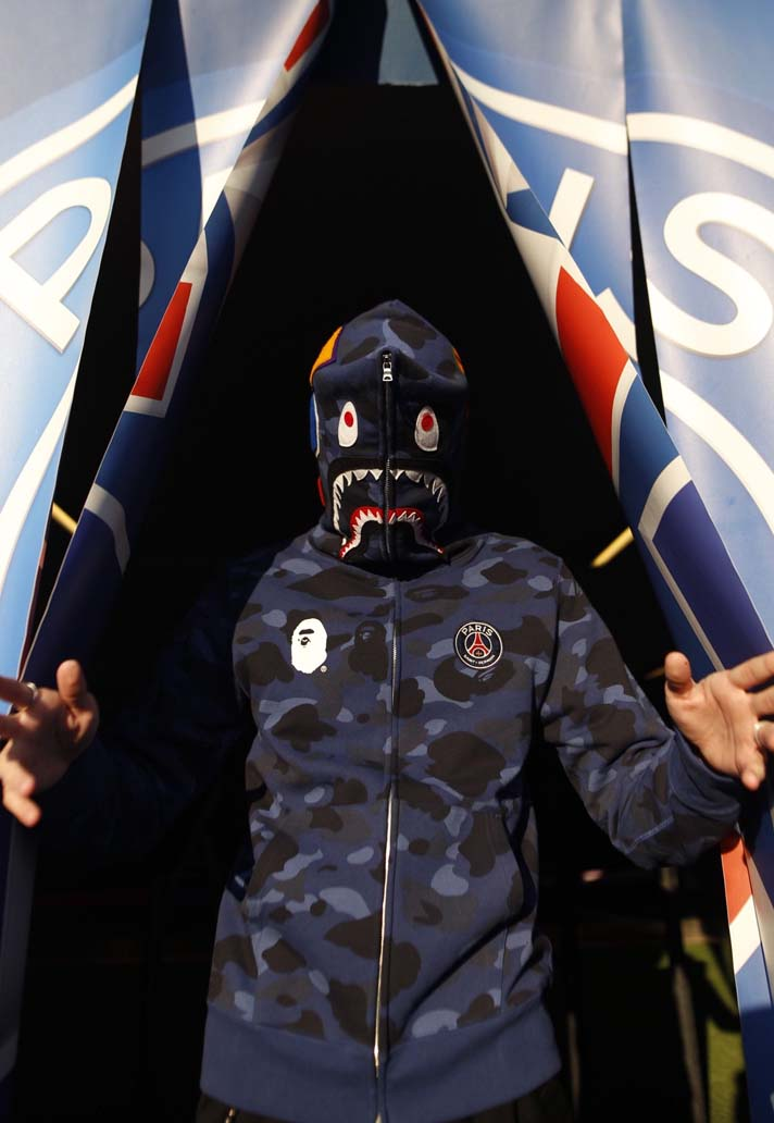 e30be66917e4d The ultra limited 13-piece capsule includes a shark hoodie with trademark  full zip and PSG branding, several tees and a long red-and-blue camo jacket  which ...