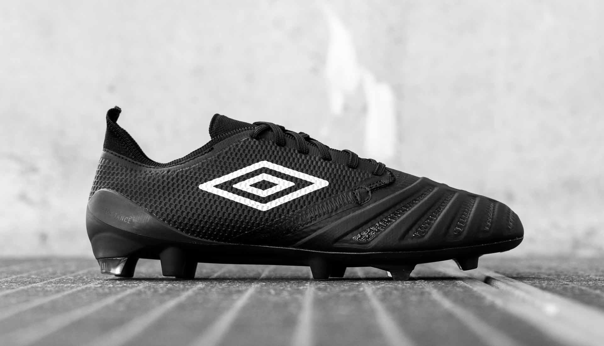 black umbro boots